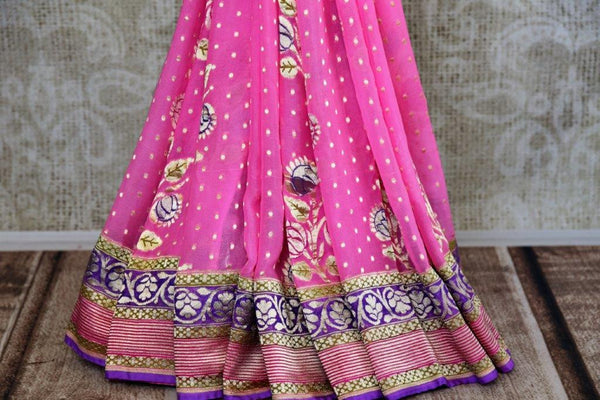 Buy pink Georgette Banarasi saree online in USA with zari border and floral buta. Pure Elegance store brings you woven Indian designer georgette saris online in USA.-pleats