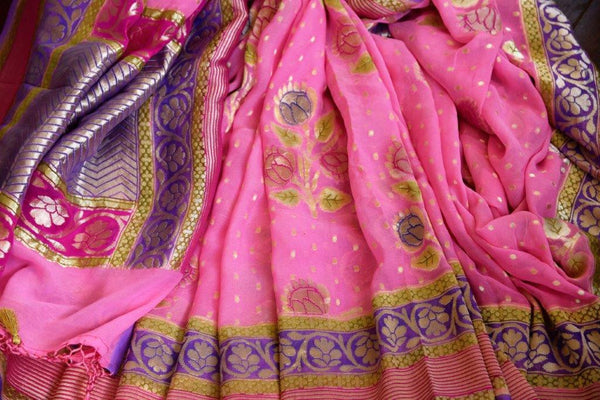 Buy pink Georgette Banarasi saree online in USA with zari border and floral buta. Pure Elegance store brings you woven Indian designer georgette saris online in USA.-details