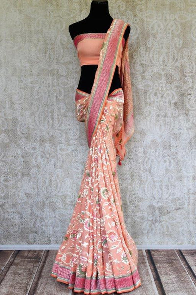 Buy light pink Georgette Banarasi sari online in USA with floral zari design. Pure Elegance store brings you hand woven Indian georgette sarees online in USA.-full view
