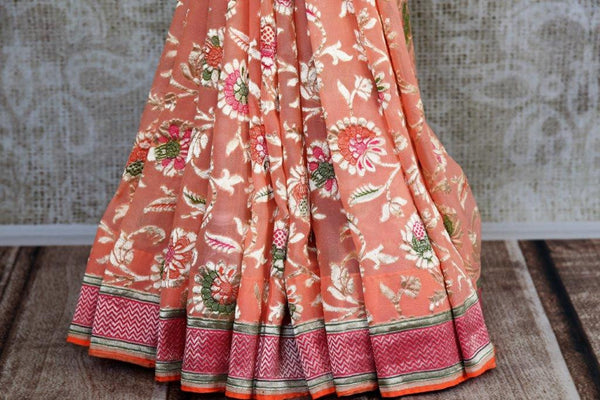Buy light pink Georgette Banarasi sari online in USA with floral zari design. Pure Elegance store brings you hand woven Indian georgette sarees online in USA.-pleats