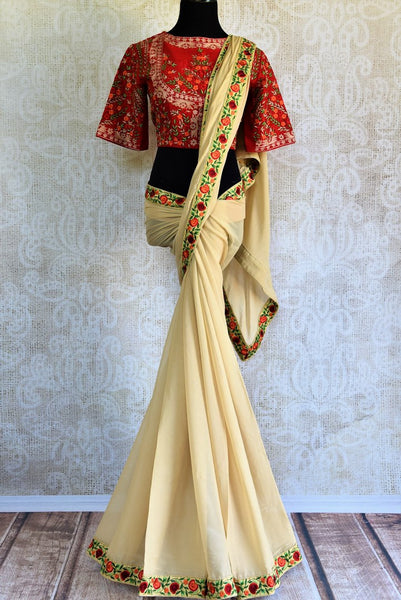 Buy stylish cream Georgette Saree online in USA with thread embroidery for party wear. Pure Elegance store brings a range of designer Indian georgette saris online.-full view