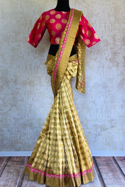 Buy beige gold Tissue Banarasi saree online in USA with pink Banarasi readymade blouse from Pure Elegance. Our store brings pure woven Indian sarees online for women.-full view