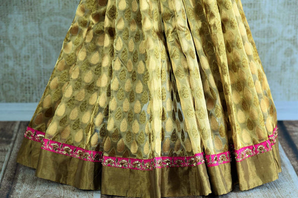 Buy beige gold Tissue Banarasi saree online in USA with pink Banarasi readymade blouse from Pure Elegance. Our store brings pure woven Indian sarees online for women.-pleats