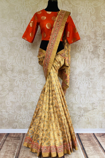Buy beige gold Tissue Banarasi sari online in USA with embroidered border and blouse from Pure Elegance. Our store brings pure woven Indian sarees online for women.-full view
