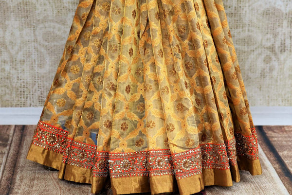 Buy beige gold Tissue Banarasi sari online in USA with embroidered border and blouse from Pure Elegance. Our store brings pure woven Indian sarees online for women.-pleats