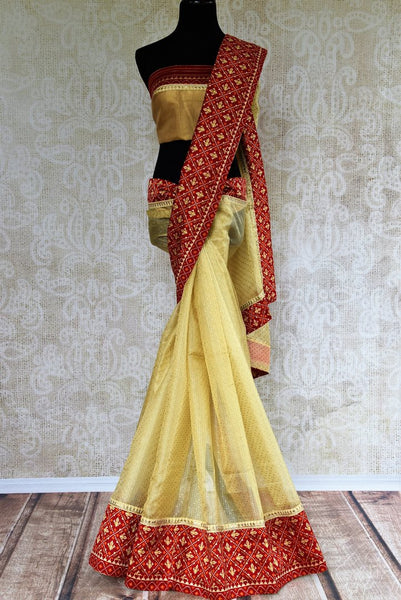 Buy cream silk Kota saree online in USA from Pure Elegance with gota patti embroidery. Our store brings woven  Indian Kota silk saris online in USA for weddings.-full view