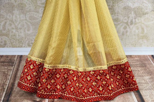 Buy cream silk Kota saree online in USA from Pure Elegance with gota patti embroidery. Our store brings woven  Indian Kota silk saris online in USA for weddings.-pleats
