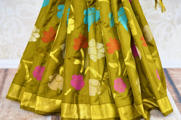 Buy elegant green Jamdani uppada silk sari online in USA. Pure Elegance presents an alluring range of woven Indian sarees online and in store in USA for various occasions.-pleats