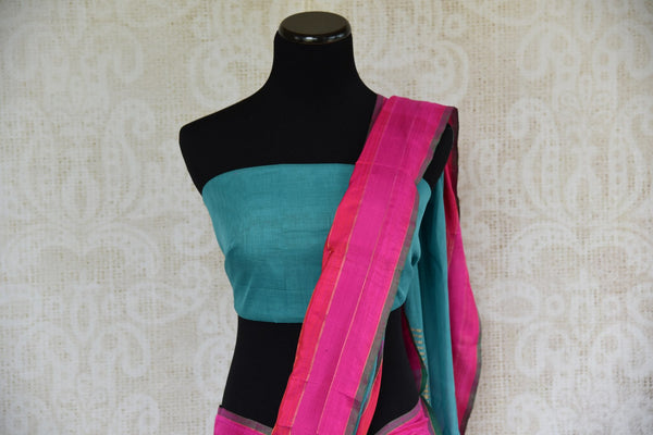 Pure Elegance store brings exquisite range of woven Indian khaddi saris online for every occasion. Buy blue khaddi silk saree online in USA with pink border for casual occasions. -pallu