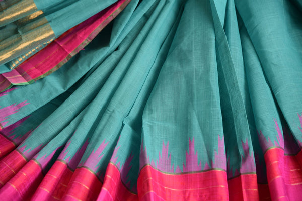 Pure Elegance store brings exquisite range of woven Indian khaddi saris online for every occasion. Buy blue khaddi silk saree online in USA with pink border for casual occasions. -details