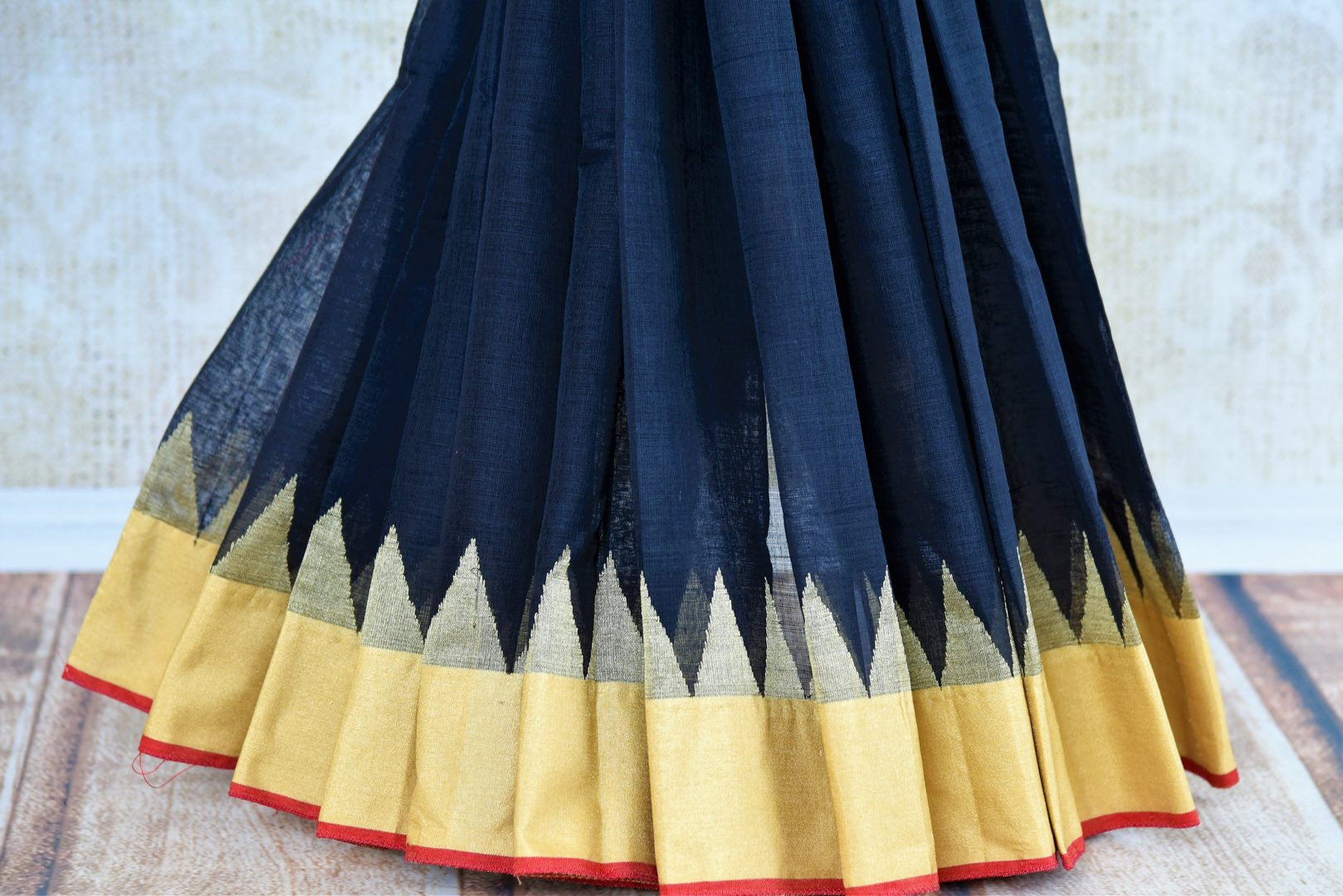Pure Elegance store brings exclusive range of woven Indian khaddi silk sarees online for every occasion. Buy classy black khaddi silk sari online in USA with gold border.-pleats
