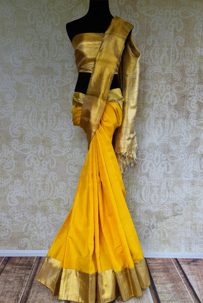 Buy yellow Kanchipuram silk saree online USA with gold zari border from Pure Elegance. Our store brings an exquisite range of Indian silk Kanjivaram sarees in USA.-full view