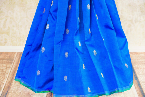 Buy blue Kanchipuram silk sari online USA with gold zari buta from Pure Elegance. Our store brings an exquisite range of ethnic Indian silk Kanjeevaram sarees.-pleats