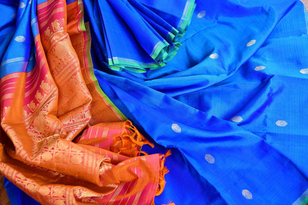 Buy blue Kanchipuram silk sari online USA with gold zari buta from Pure Elegance. Our store brings an exquisite range of ethnic Indian silk Kanjeevaram sarees.-details