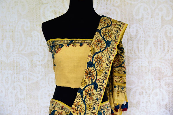 Buy classy beige and blue linen Kalamkari printed saree online in USA. Pure Elegance store presents an exclusive collection of Indian printed Kalamkari saris in USA.-pallu