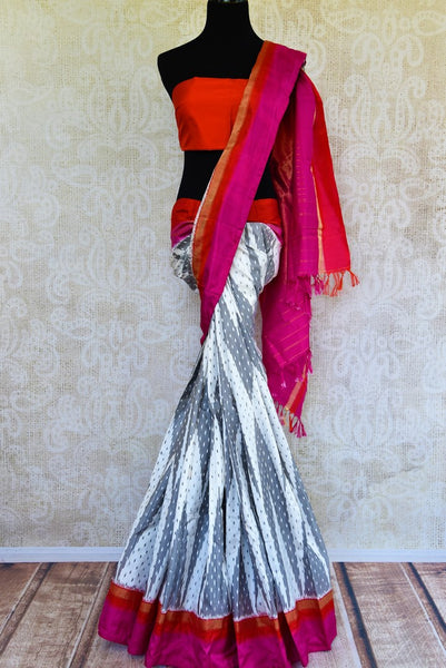 Buy grey and white ikat silk saree online from Pure Elegance with pink and red border. Our Indian fashion store in USA brings an alluring range of ikkat sarees for women.-full view