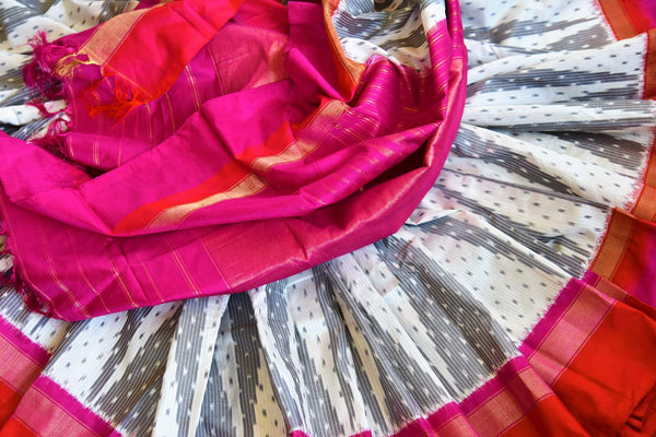 Buy grey and white ikat silk saree online from Pure Elegance with pink and red border. Our Indian fashion store in USA brings an alluring range of ikkat sarees for women.-details