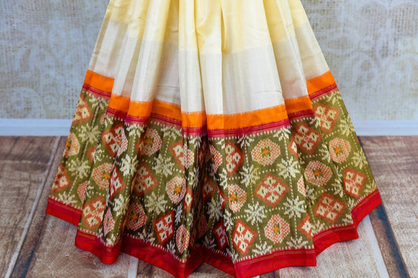 Buy elegant off white silk ikat saree online in USA from Pure Elegance. Our Indian fashion store brings a stunning range of pure woven ikkat silk sarees in USA.-pleats