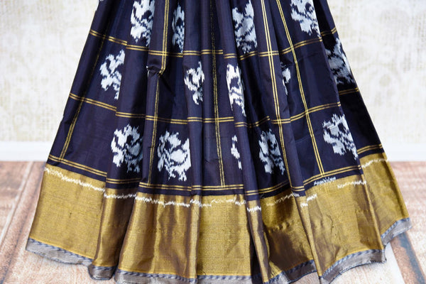 Buy elegant black silk ikkat sari online in USA with checker pattern from Pure Elegance. Our Indian fashion store brings an alluring range of ikkat silk sarees in USA.-pleats