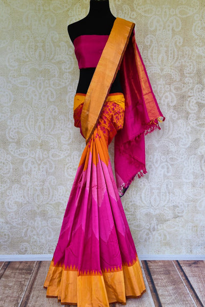 Buy pink silk ikkat saree online in USA with orange zari border from Pure Elegance. Our Indian fashion store brings an alluring range of festive ikat silk sarees in USA.-full view