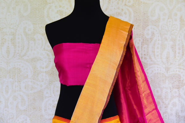 Buy pink silk ikkat saree online in USA with orange zari border from Pure Elegance. Our Indian fashion store brings an alluring range of festive ikat silk sarees in USA.-pallu