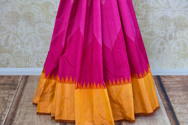Buy pink silk ikkat saree online in USA with orange zari border from Pure Elegance. Our Indian fashion store brings an alluring range of festive ikat silk sarees in USA.-pleats