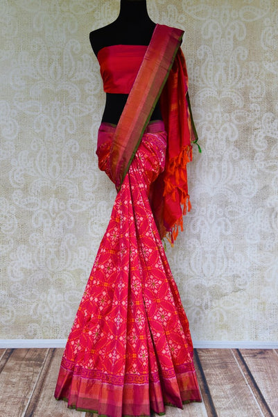 Buy ethnic dark pink silk ikat sari online in USA from Pure Elegance. Our Indian fashion store brings an alluring range of festive woven silk ikkat sarees in USA.-full view