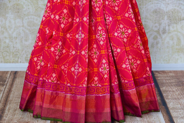 Buy ethnic dark pink silk ikat sari online in USA from Pure Elegance. Our Indian fashion store brings an alluring range of festive woven silk ikkat sarees in USA.-pleats