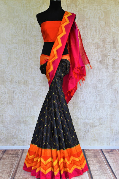 Buy black ikat silk saree online in USA with multicolor border from Pure Elegance. Our Indian fashion store brings an alluring range of woven silk ikkat sarees in USA.-full view