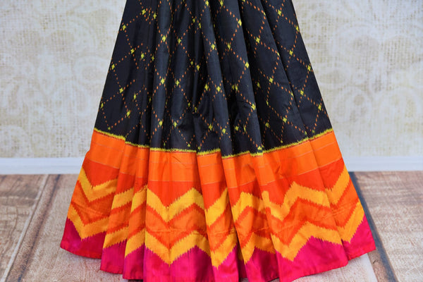 Buy black ikat silk saree online in USA with multicolor border from Pure Elegance. Our Indian fashion store brings an alluring range of woven silk ikkat sarees in USA.-pleats