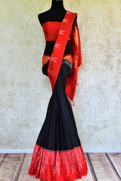 Buy classic black silk saree online in USA with red ikkat border from Pure Elegance. Our Indian fashion store brings an alluring range of silk ikkat sarees in USA.-full view