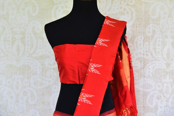 Buy classic black silk saree online in USA with red ikkat border from Pure Elegance. Our Indian fashion store brings an alluring range of silk ikkat sarees in USA.-pallu