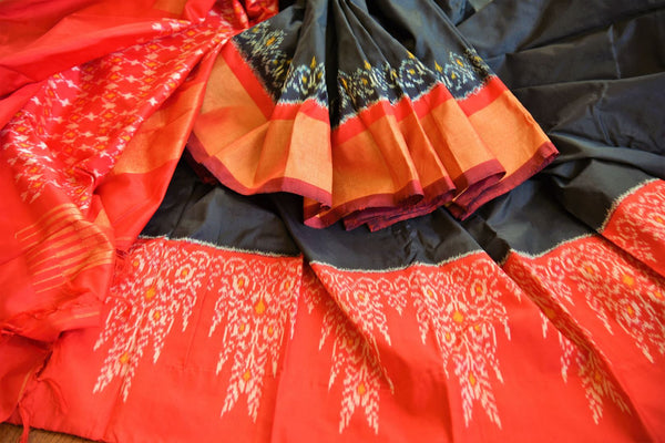 Buy classic black silk saree online in USA with red ikkat border from Pure Elegance. Our Indian fashion store brings an alluring range of silk ikkat sarees in USA.-details