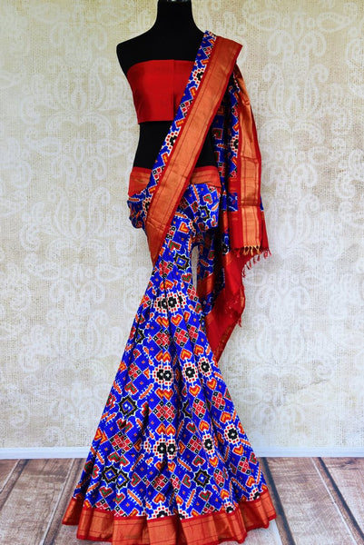Buy blue double ikat Patola silk saree online in USA from Pure Elegance. Our Indian fashion store brings an alluring range of silk ikkat sarees in USA for women.-full view