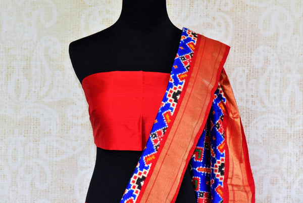 Buy blue double ikat Patola silk saree online in USA from Pure Elegance. Our Indian fashion store brings an alluring range of silk ikkat sarees in USA for women.-pallu