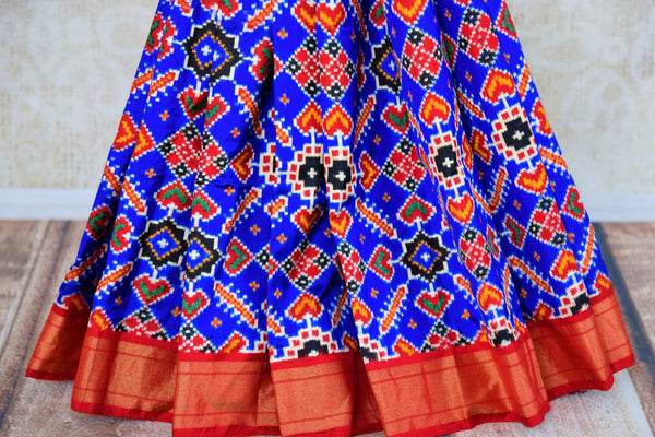 Buy blue double ikat Patola silk saree online in USA from Pure Elegance. Our Indian fashion store brings an alluring range of silk ikkat sarees in USA for women.-pleats