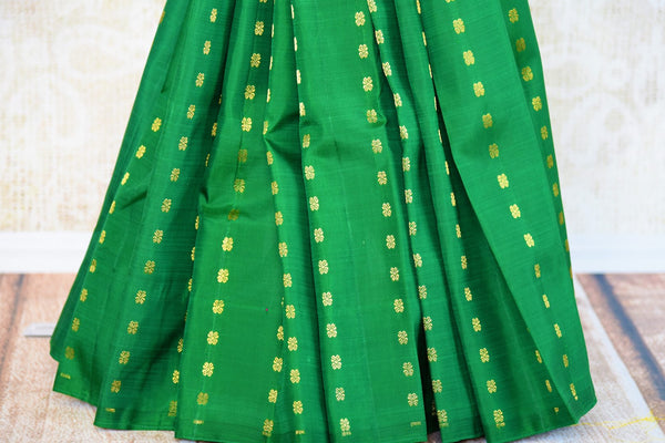 Buy green and pink Kanchipuram silk saree online in USA from Pure Elegance. Our Indian fashion store brings a stunning range of traditional Kanjivaram sarees in USA.-pleats