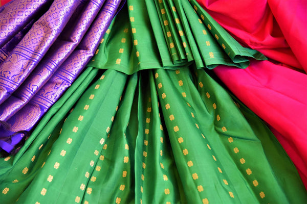 Buy green and pink Kanchipuram silk saree online in USA from Pure Elegance. Our Indian fashion store brings a stunning range of traditional Kanjivaram sarees in USA.-details