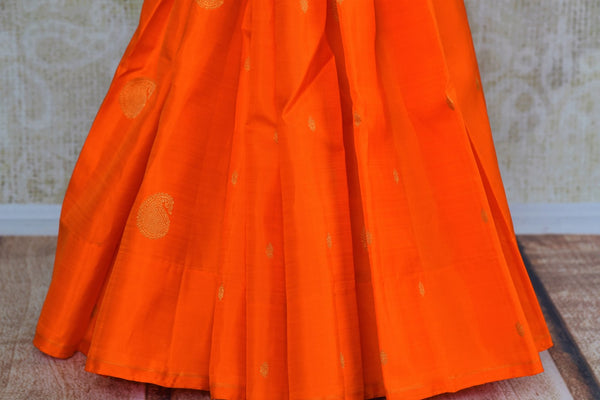 Buy orange and black Kanjeevaram silk saree online in USA. Browse through a stunning range of traditional Indian Kanjivaram sarees at Pure Elegance online store.-pleats