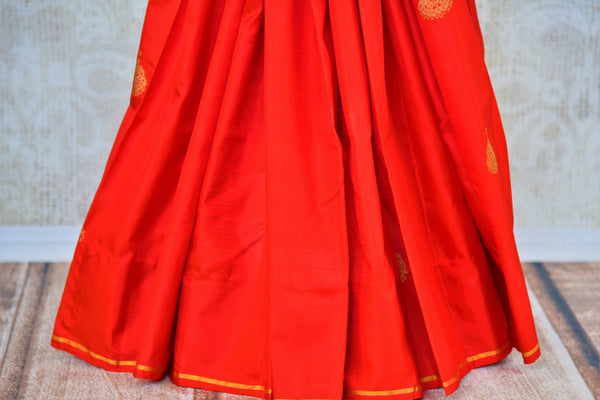 Buy half red and half white Kanjivaram silk saree online in USA from Pure Elegance. Our Indian fashion store brings exquisite range of Kanjeevaram sarees in USA.-pleats