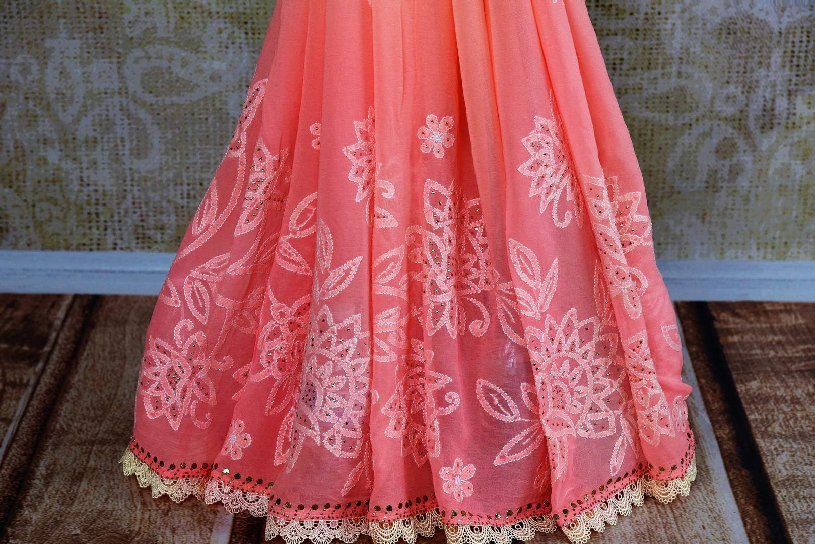 Buy pink embroidered Luchnowi saree online from Pure Elegance with readymade blouse. Our Indian fashion store brings alluring range of Lucknowi saris in USA for women.-pleats