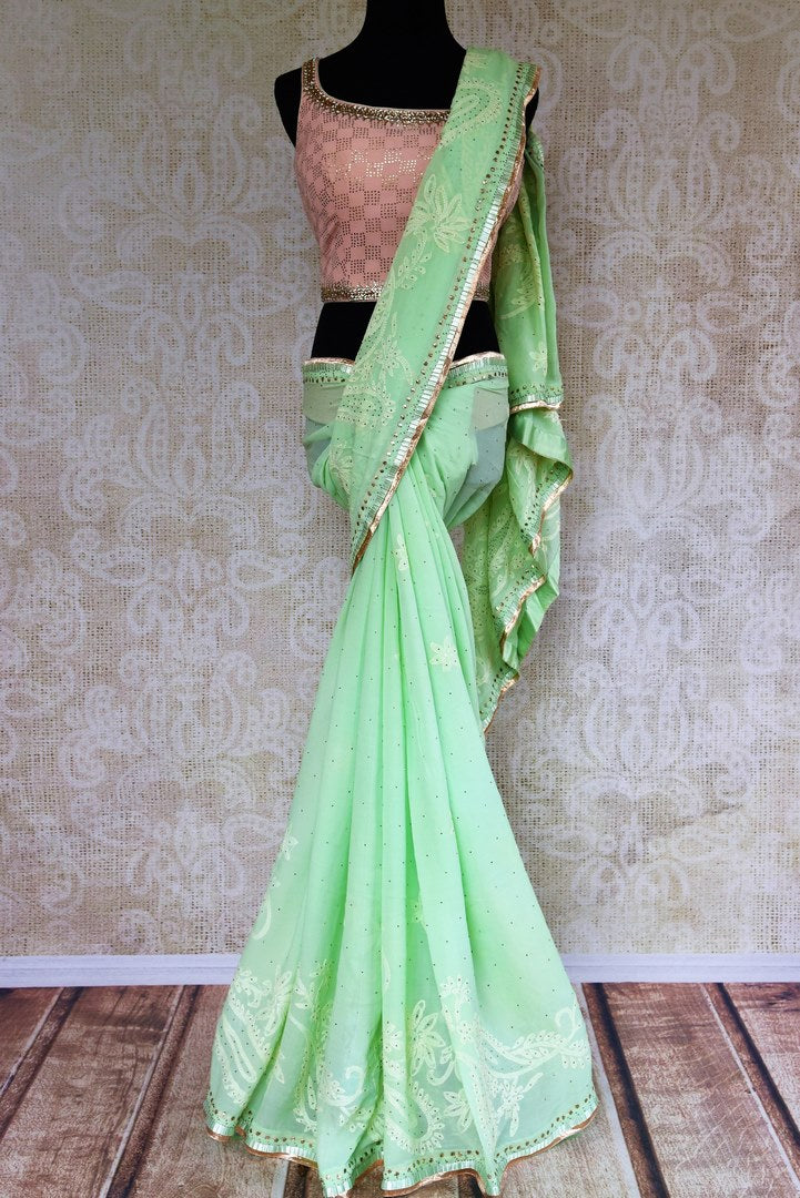 Buy mint green Luchnowi georgette saree online from Pure Elegance with blouse. Our Indian fashion store brings alluring range of Lucknowi sarees in USA for women.-full view