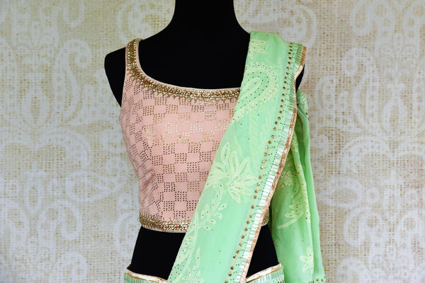 Buy mint green Luchnowi georgette saree online from Pure Elegance with blouse. Our Indian fashion store brings alluring range of Lucknowi sarees in USA for women.-pallu