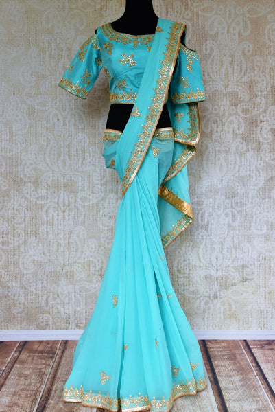 Buy blue embroidered georgette saree online from Pure Elegance with blouse. Our Indian fashion store brings alluring range of wedding sarees in USA for women.-full view