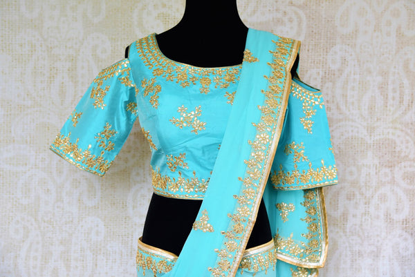 Buy blue embroidered georgette saree online from Pure Elegance with blouse. Our Indian fashion store brings alluring range of wedding sarees in USA for women.-pallu