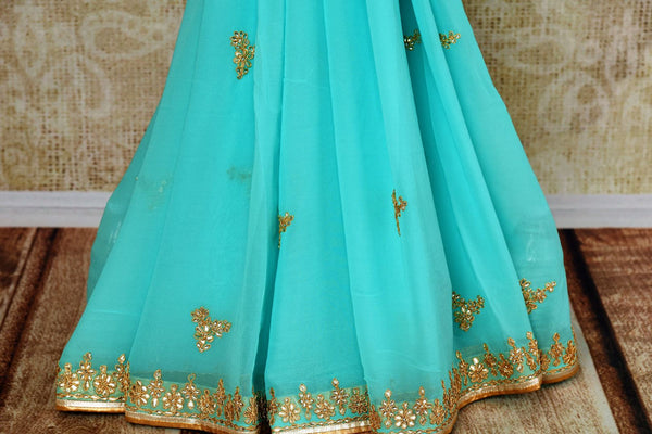 Buy blue embroidered georgette saree online from Pure Elegance with blouse. Our Indian fashion store brings alluring range of wedding sarees in USA for women.-pleats