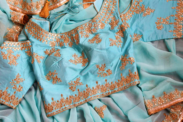 Buy blue embroidered georgette saree online from Pure Elegance with blouse. Our Indian fashion store brings alluring range of wedding sarees in USA for women.-details