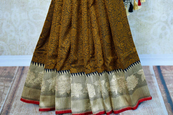 Buy black Banarasi saree online in USA with brown resham work. Browse through an exquisite range of Indian Banarasi sarees at Pure Elegance online store in USA.-pleats