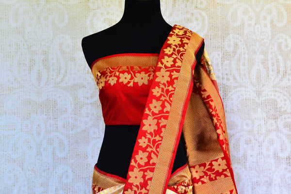 Buy off white Banarasi silk saree online in USA with red floral border. Get your hands on ethnic Indian woven Banarasi silk sarees at Pure Elegance online store in USA now.-pallu