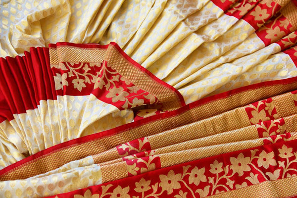 Buy off white Banarasi silk saree online in USA with red floral border. Get your hands on ethnic Indian woven Banarasi silk sarees at Pure Elegance online store in USA now.-details